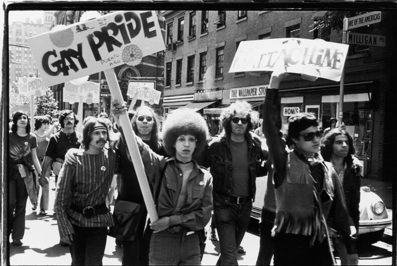 People hold 'Gay Pride' and 'Mattchine' (The Mattachine Society was a early American gay rights organization) signs during the first Stonewall anniversary march, then known as Christopher Street Liberation Day (and later Gay Pride Day), as they parade along 6th Avenue in New York, June 28, 1970.