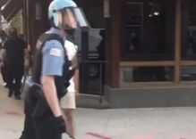 """Police officer caught on video calling a protestor a """"fa***t"""""""