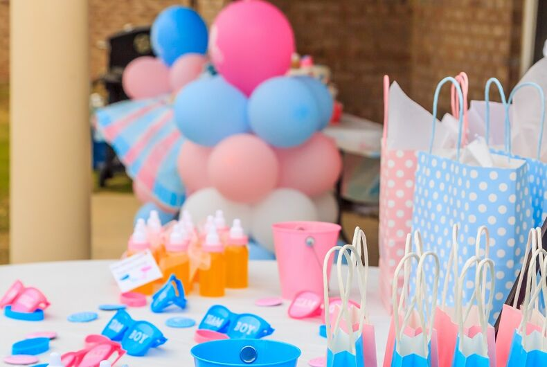 A gender reveal party stock image that uses trans flag colors, probably by accident