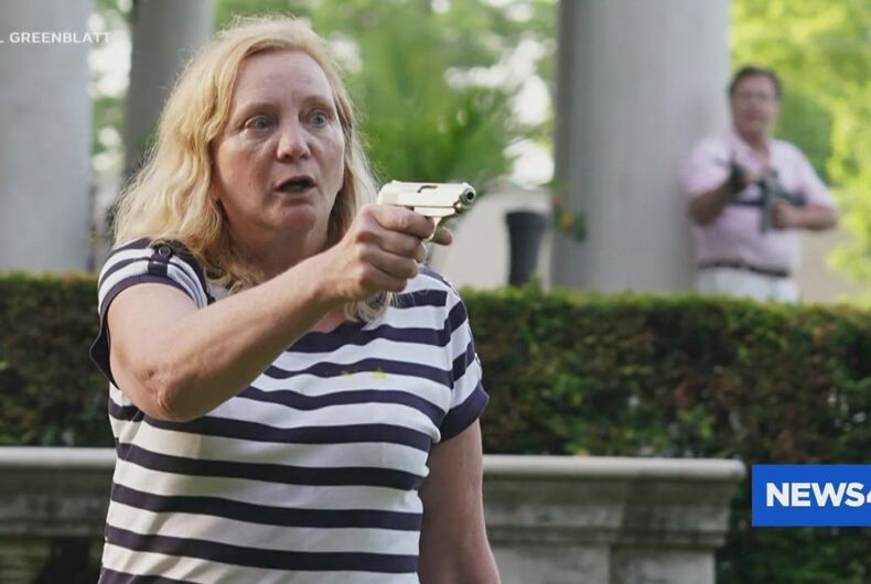 Patricia McCloskey holds a gun on a group of protestors passing by her home