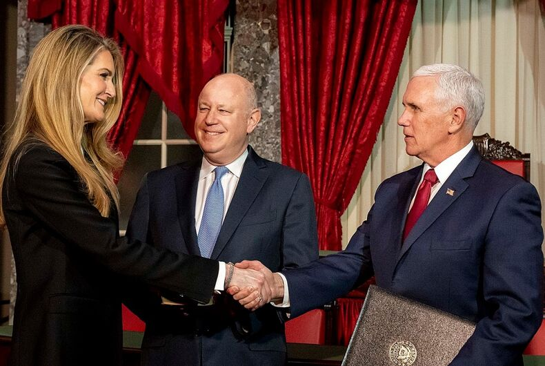 Kelly Loeffler being sworn in by Mike Pence