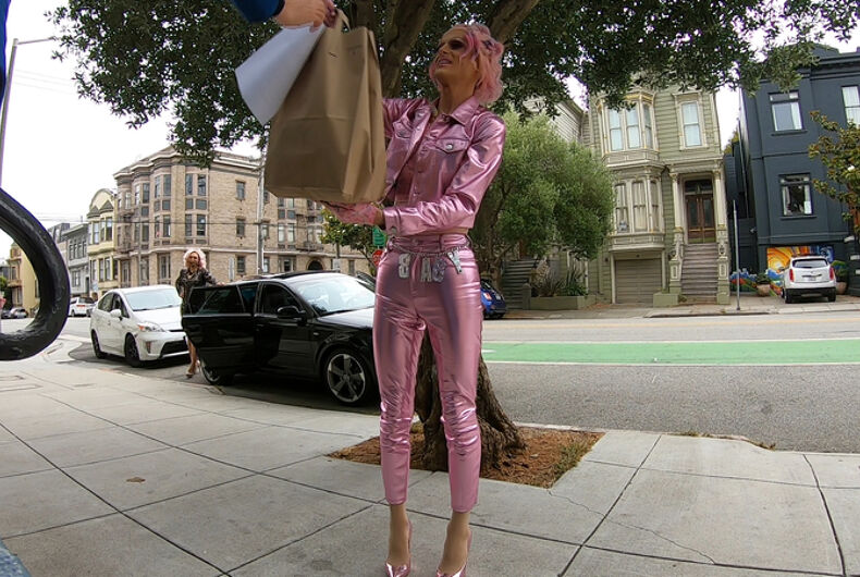 Drag performer Lindsey Slowhands makes a delivery for