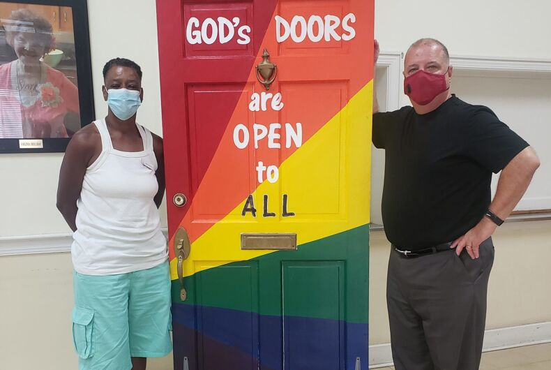 Rev. Billy Hester (right) and a congregant of Asbury Memorial Church, in front of the model of