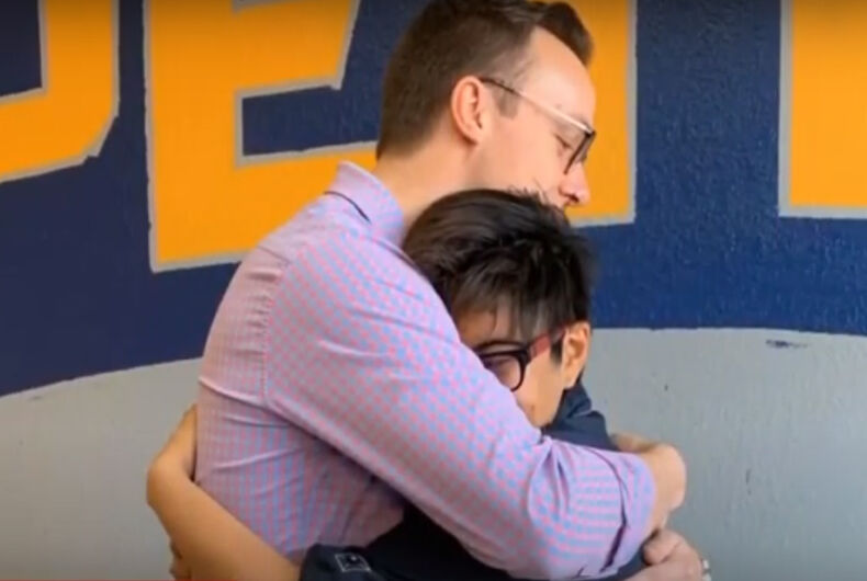 Chasten hugging a boy