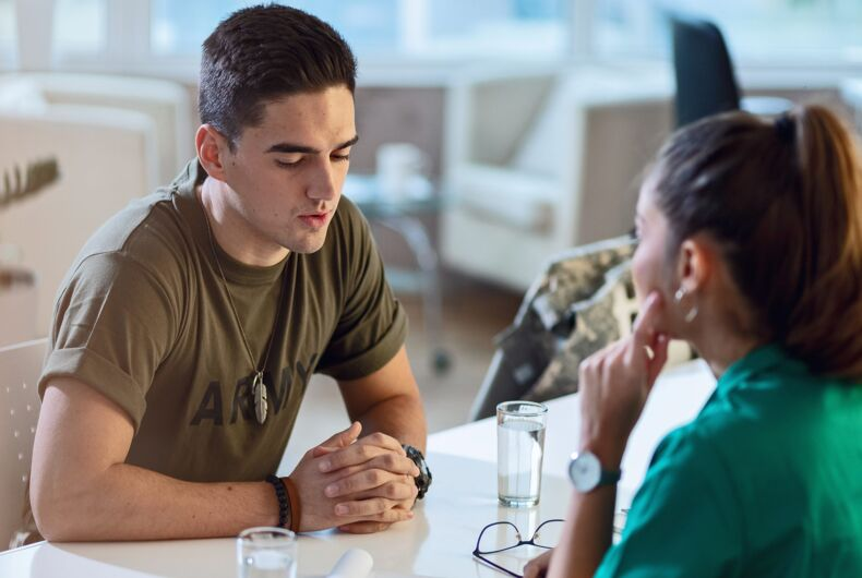 A soldier talking to a doctor. It's just a stock image, it's not deep.