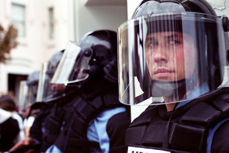 Police in full riot gear and batons guard Gap stores during anti-sweatshop protests on Sept. 27, 2002 in Washington, DC.