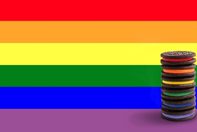Limited edition Rainbow OREOs in front of the Pride flag.