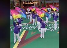 An LGBTQ marching band performs during the Thanksgiving Day Parade for the first time in history