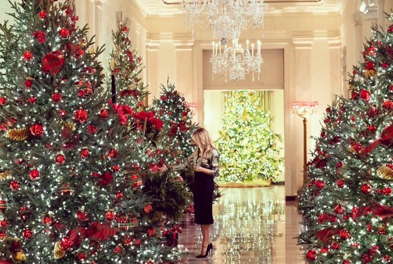 First Lady Melania Trump looks at the White House Christmas decorations.