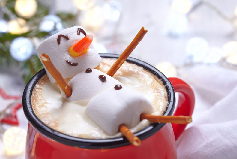 A marshmallow figure in hot cocoa and it looks happy