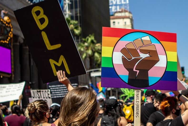 June 14, 2020: Protesters hold BLM and a rainbow fist sign at the All Black Lives Matter march in Hollywood