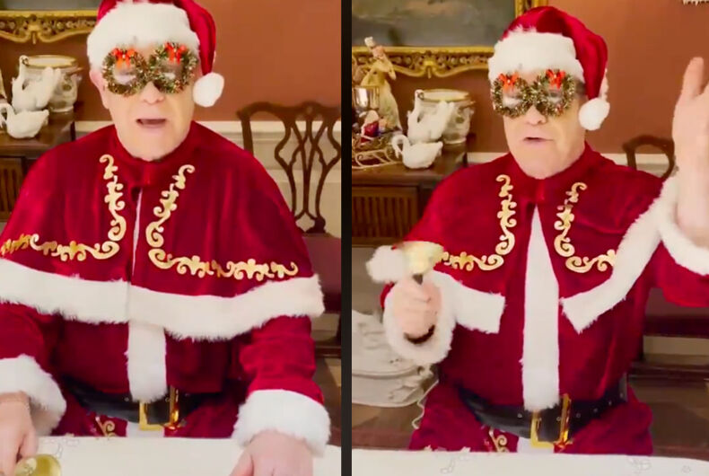 Elton John in his Santa costume, ringing jingle bell and glasses made of wreaths.