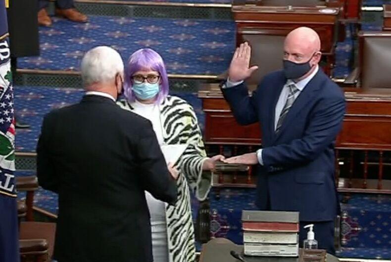 Vice President Mike Pence swears in Sen. Mark Kelly (D-AZ) as Sen. Kyrsten Sinema (D-AZ) holds the Bible.