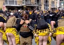 Proud Boys wearing kilts made by gay men flash protesters during MAGA rally