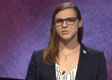 A transgender woman won Jeopardy! She wore a trans flag pin to represent.