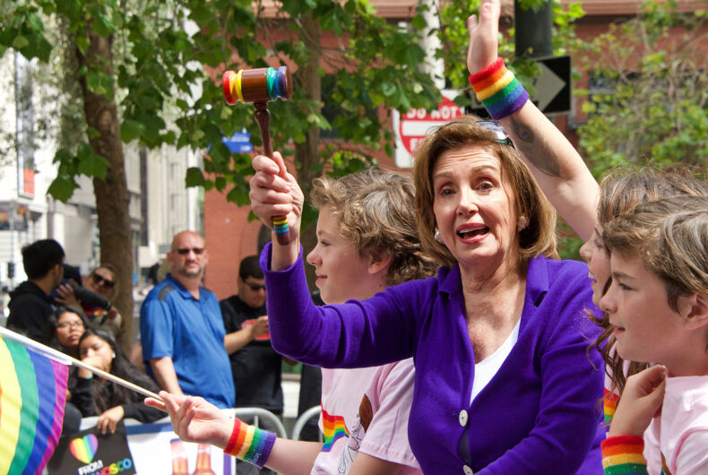 San Francisco, CA - June 30, 2019: Nancy Pelosi holds up a rainbow colored gavel in the 49th annual Gay Pride Parade, one of the oldest and largest LGBTQIA parades in the world, over 200 contingents and more than 100,000 spectators.
