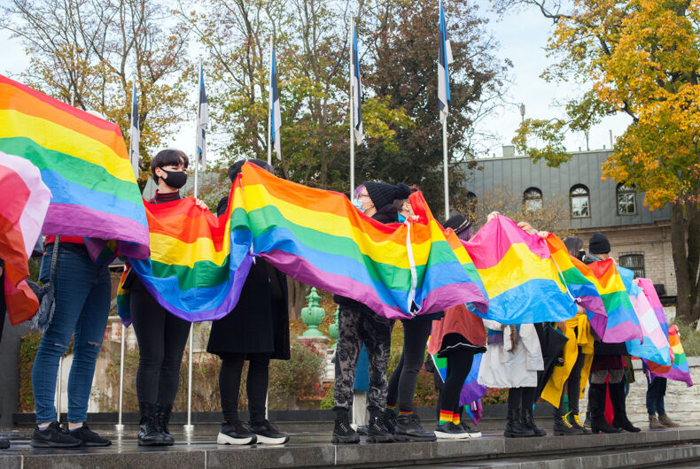 Tallinn, Estonia - OCT 18, 2020: people with flags for the universal right to marriage on freedom square