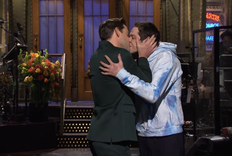 John Krasinski (left) smooches Pete Davidson (right) on Saturday Night Live