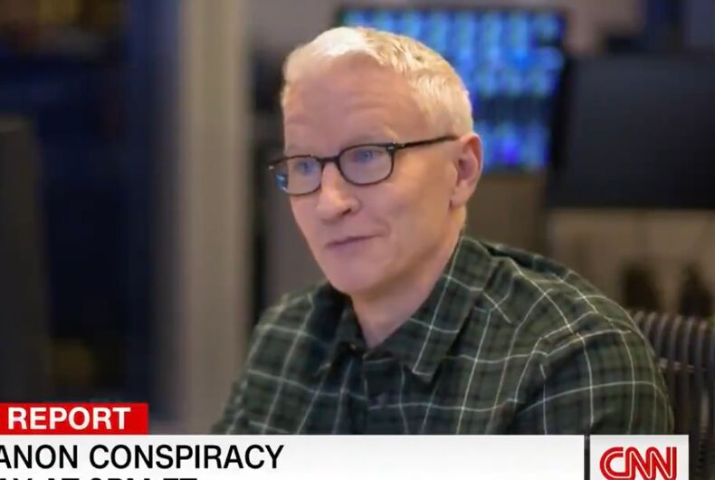 Anderson Cooper interviewing Jitarth Jadeja for a CNN special report on QAnon.
