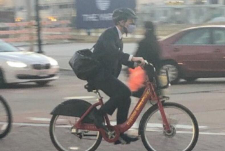 Pete Buttigieg cycling through the streets of Washington D.C.