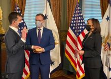 Pete Buttigieg sworn in as the first out Cabinet Secretary in touching ceremony with Kamala Harris