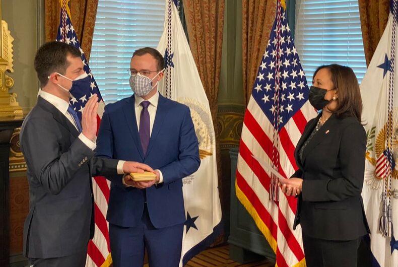 Pete Buttigieg getting sworn in by Kamala Harris with Chasten Buttigieg by his side.