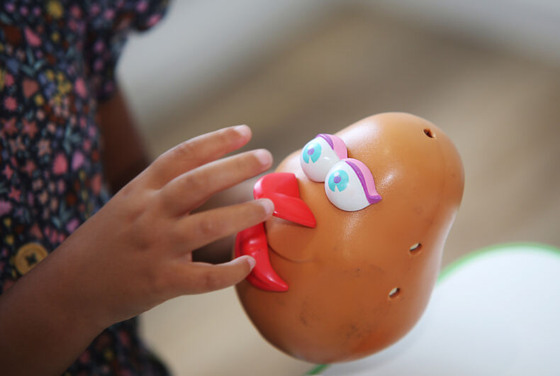 Coffs Harbour, NSW / Australia - Jan 2nd 2020: A child plays with a Mrs. Potato Head toy as part of a speech therapy session.