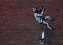 """Bob Ross is """"helping"""" Banksy debut his new street art painted on a prison wall"""