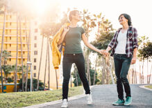 Bi women in relationships with lesbians more likely to be out, happier, & face more discrimination