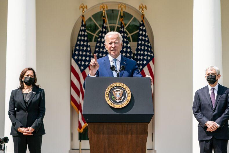 President Joe Biden (center) delivering remarks from the White House Rose Garden on April 8, 2021, alongside Vice President Kamala Harris (left) and Attorney General Merrick Garland (right), regarding gun violence.