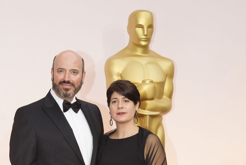 Scott Rudin (left) and a guest at the 2015 Oscars ceremony