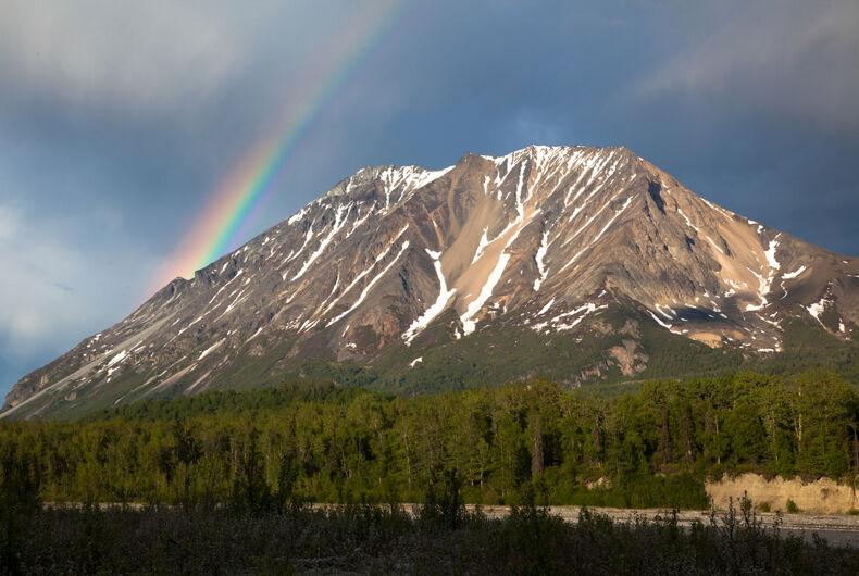 a rainbow and a mountain in alaska