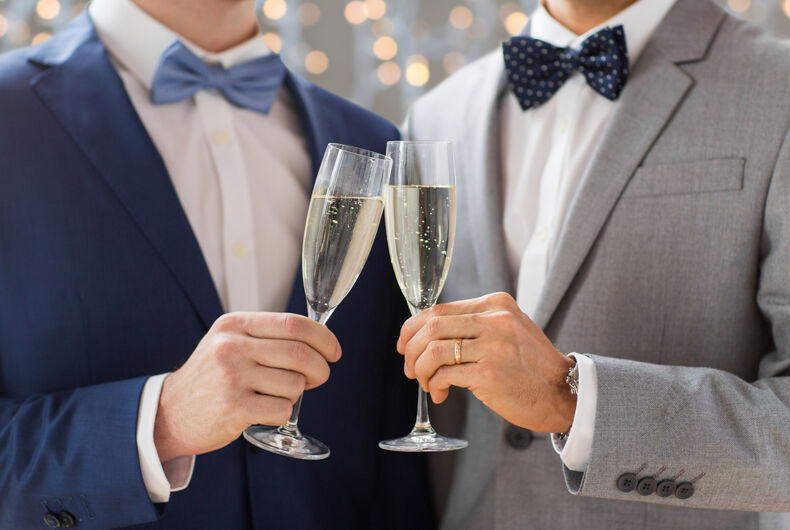 Two men getting married. they have bubbly wine