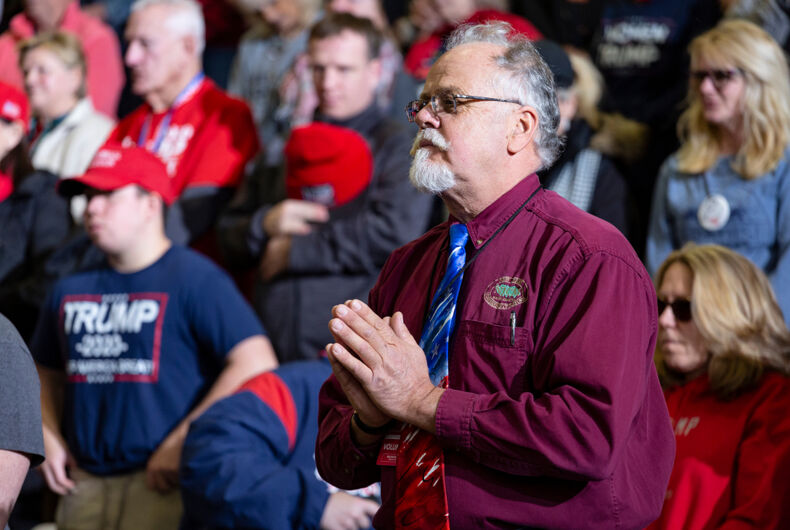 Wildwood, New Jersey - January 28, 2020: Man holds hands together in prayer during opening ceremonies at President Donald Trump's