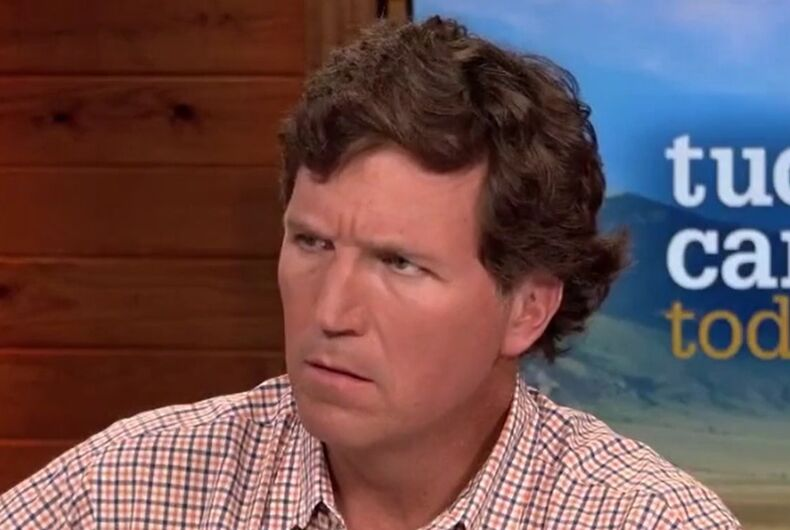 Tucker Carlson with his trademark