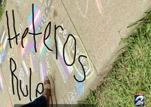 "Middle school teacher loses control & scrawls ""heteros rule"" over students' Pride flag chalk art"