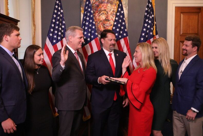 Rep. Marjorie Taylor Greene (right) being sworn in by House Minority Leader Kevin McCarthy under a portrait of the late Ronald Reagan