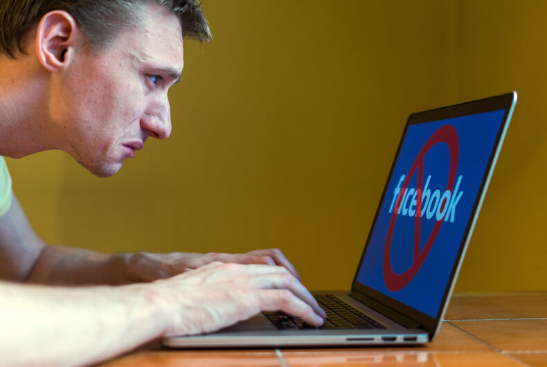 APRIL 21, 2018: A young man is upset near a computer.