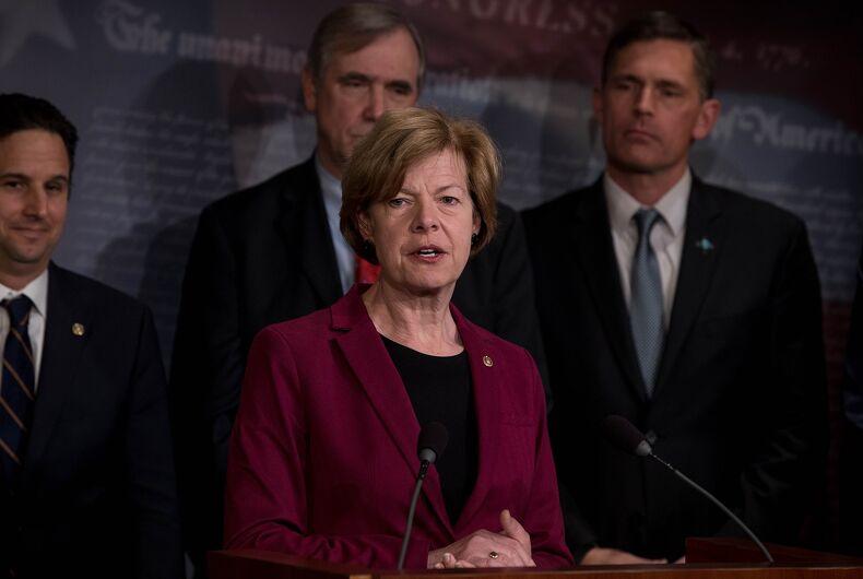 Sen. Tammy Baldwin speaking alongside other Senators at a press conference in 2019.