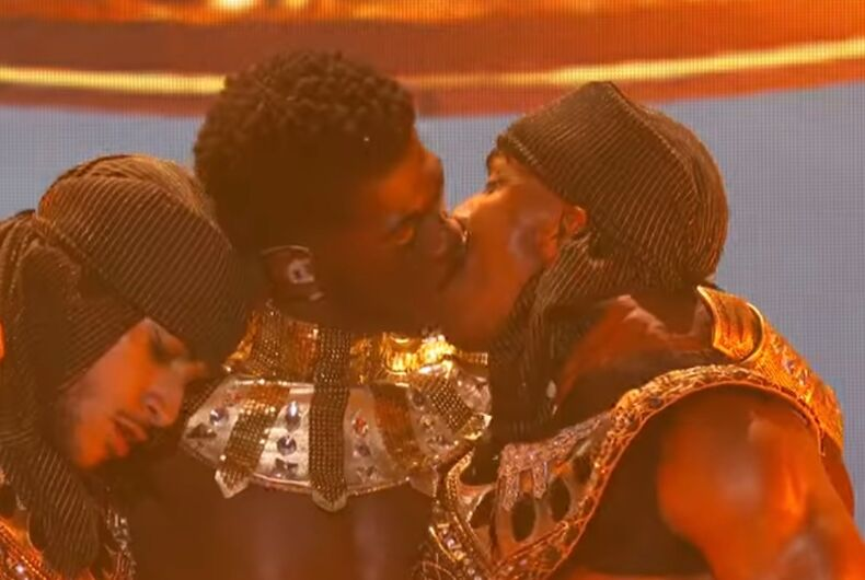 Lil Nas X kissing one of his performers at the 2021 BET Awards on June 27, 2021