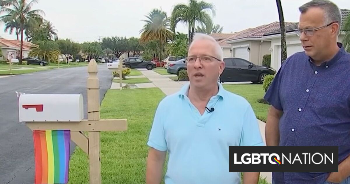 A gay couple was ordered to take down their Pride flag & now their neighbors are flying them too