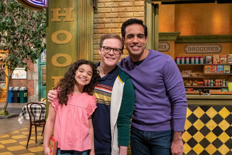 Dave, his husband Frank, and their daughter Mia are being welcomed to Sesame Street.