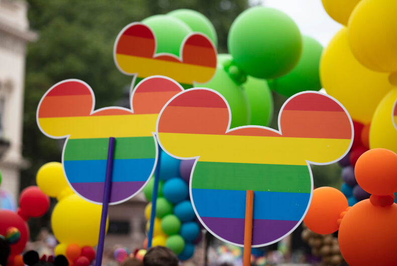 Mickey Mouse icon with gay rainbow flag design at the annual gay pride march in central London