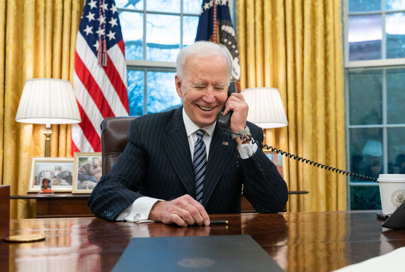 President Joe Biden talks on the phone with Katherine Tai in the Oval Office of the White House Thursday, March 18, 2021, to congratulate her on her confirmation as U.S. Trade Representative. (Official White House Photo by Adam Schultz)