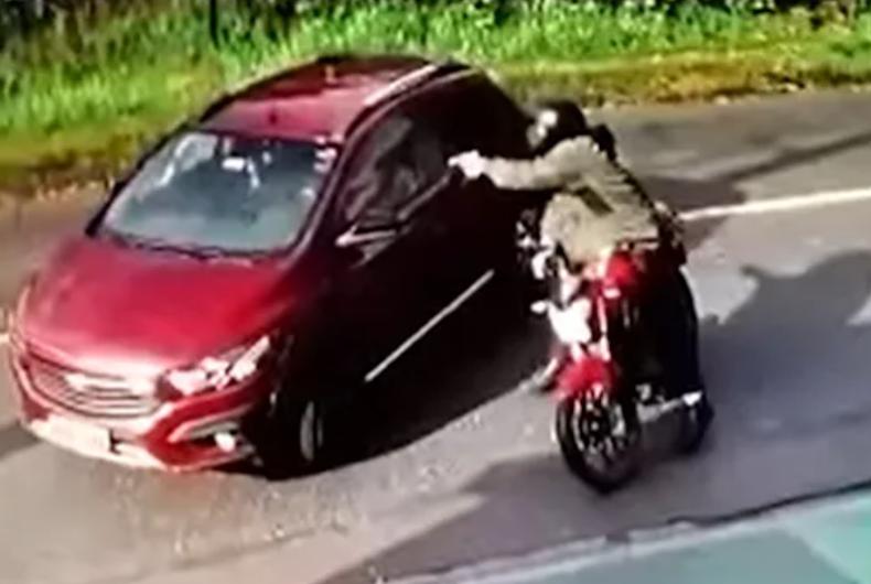 The gunman shooting Ana Paula Campestrini's car.