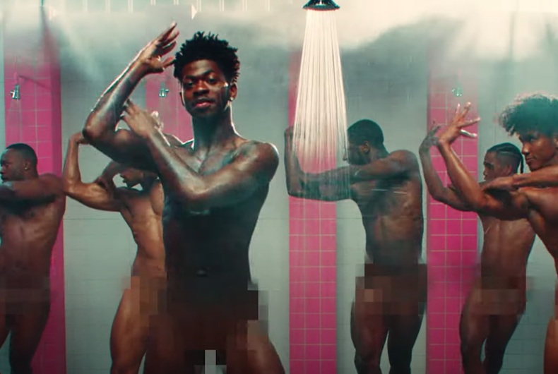 Lil Nas X dances in a prison shower in his video for