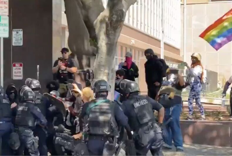 Los Angeles police officers attack leftwing protestors outside an LA spa.