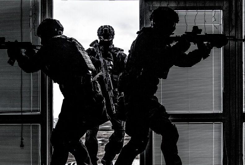 Police raiding a building