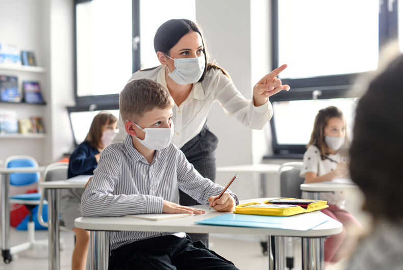Teacher and a student with masks.