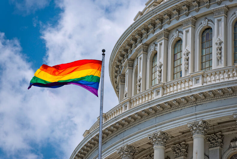 Washington DC Capitol dome detail with waving Rainbow flag